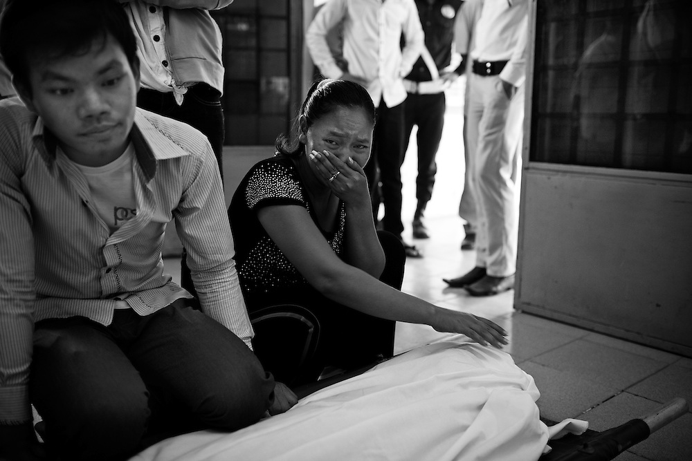 A new family member arrives to find her loved one has been lost in the stampede tragedy in Phnom Penh Cambodia on November 22nd, 2010. Nearly 400 people lost their lives when thousands tried to flee Diamond Island over a bridge. The cause of the panic has still not been confirmed.