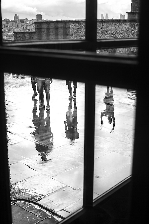 Visitors reflected on the rain ponds in one terrace at Topkapi Palace in Istanbul.
