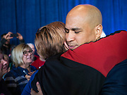 05 DECEMBER 2019 - DES MOINES, IOWA: US Senator CORY BOOKER (D-NJ) hugs a supporter after he finished his formal speech in Des Moines Friday. He talked about the need to reunify the country. Senator Booker is running to be the Democratic nominee for the US Presidency in 2020. Iowa hosts the first selection event of the presidential election season. The Iowa caucuses are February 3, 2020.       PHOTO BY JACK KURTZ