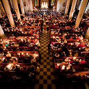 December 5, 2010 - Bronx, NY : Manhattan College hosted its annual evening of holiday music this past Sunday in in the Collegeís Chapel of De La Salle and His Brothers. The chapel is filled with candle light as the chorus and orchestra lead the assembly in a rousing rendition of Silent Night.