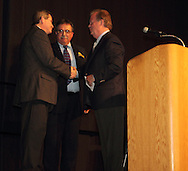 (from left) MC Karl Keith, Montgomery County Democratic Party chair Mark Owens and Former Congressman and former U.S. Ambassador Tony P. Hall after receiving the lifetime achievement award during the Montgomery County Democratic Party's annual Frolic for Funds at the Dayton Convention Center in downtown Dayton, Thursday, March 29, 2012.
