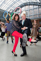© Licensed to London News Pictures. 05/07/2012. London, England. Choreographer Arlene Phillips and London Mayor Boris Johnson dancing. Official launch of Big Dance 2012, the UK's biggest celebration of dance at St Pancras International Station. Photo credit: Bettina Strenske/LNP