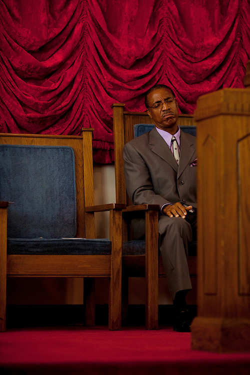 Reverend Dr. Calvin E. Collins, Pastor of New Zion Missionary Baptist Church on Carrolton Avenue in Greenwood, Mississippi closes his eyes during a worship song during a service on Sunday, September 26, 2010.
