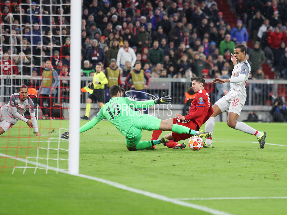 Robert Lewandowski of Bayern Munich trying to reach the ball during the Champions League round of 16, leg 2 of 2 match between Bayern Munich and Liverpool at the Allianz Arena stadium, Munich, Germany on 13 March 2019.