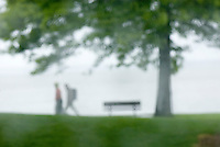 Couple walking through waterfront park in the rain, Bellingham Washington