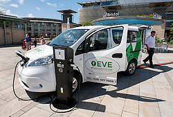 © Licensed to London News Pictures. 06/06/2015. Bristol, UK.  A Nissan ENV 200, the world's first electric notability vehicle converted by Vic Young to take wheelchairs.   The Nissan savings in running costs are £31,000 over 5 years.  At a display of electric, hybrid, and low emission vehicles at Bristol's Millennium Square sponsored by EDF energy. The cars are engineered to produce no or low emissions and pollution to reduce the impact of transport on the environment.  Photo credit : Simon Chapman/LNP