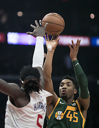 January 16, 2019 - Los Angeles, California, United States of America - Montrezl Harrell #5 of the Los Angeles Clippers tries to block a shot by Donovan Mitchell #45 of the Utah Jazz during their NBA game  on Wednesday January 16, 2019 at the Staples Center in Los Angeles, California. Clippers lose to Jazz, 129-109. JAVIER ROJAS/PI (Credit Image: © Prensa Internacional via ZUMA Wire)