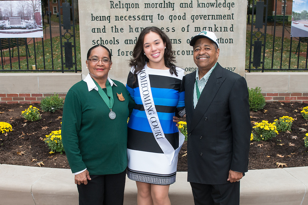 Ohio University President, Roderick McDavis, and Ohio University First Lady, Deborah McDavis, pose with Sasha Estrella-Jones, a member of Ohio University's Homecoming Court, at the College Gateway on October 8, 2016.