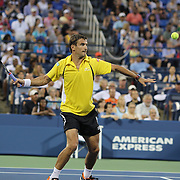 Tommy Robredo, Spain, in action during his win over Roger Federer, Switzerland, on Louis Armstrong Stadium during the Men's Singles competition at the US Open. Flushing. New York, USA. 2nd September 2013. Photo Tim Clayton