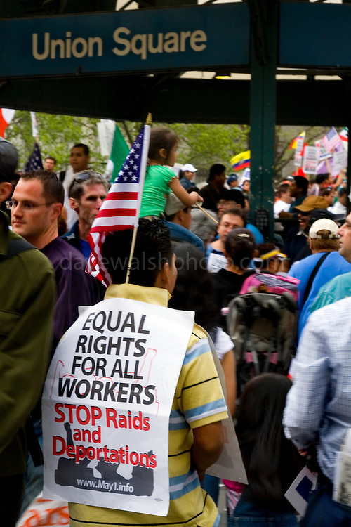 Protester in  Union Square wearing sign: Equal Rights for All Workers..Immigration Demonstration in Union Square, New York, United States