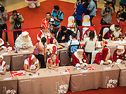 "17 SEPTEMBER 2015 - BANGKOK, THAILAND: Santa Clauses at the World Santa Claus Congress. The ""wai"" is the traditional Thai greeting. Twenty-six Santa Clauses from around the world are in Bangkok for the first World Santa Claus Congress. The World Santa Claus Congress has been an annual event in Denmark since 1957. This year's event, hosted by Snow Town, a theme park with a winter and snow theme, hosted the event. There were Santas from Japan, Hong Kong, the US, Canada, Germany, France and Denmark. They presented gifts to Thai children and judged a Santa pageant. Thailand, a Buddhist country, does not celebrate the religious aspects of Christmas, but Thais do celebrate the commercial aspects of the holiday.    PHOTO BY JACK KURTZ"
