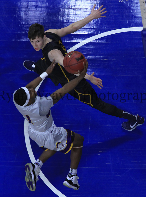 Shannon James, Jr., of Louisiana State University-Alexandria drives past Graceland University's Dalton Payton in the NAIA championship game Tuesday at Municipal Auditorium.
