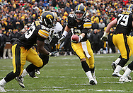 15 NOVEMBER 2008: Iowa quarterback Ricky Stanzi (12) hands the ball off to Iowa running back Shonn Greene (23) in the second half of an NCAA college football game against Purdue, at Kinnick Stadium in Iowa City, Iowa on Saturday Nov. 15, 2008. Iowa beat Purdue 22-17.