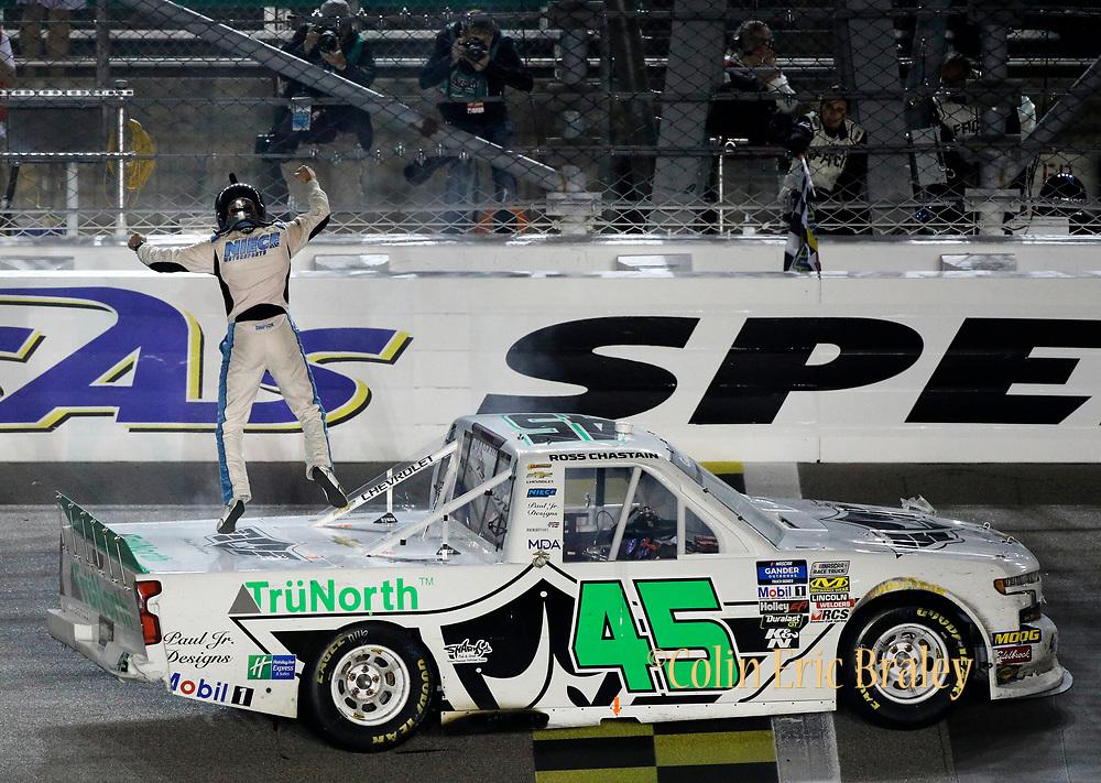 Kansas City Racing Photographer- Ross Chastain celebrates winning a NASCAR Truck Series auto race at Kansas Speedway in Kansas City, Kan., Friday, May 10, 2019. (AP Photo/Colin E. Braley)
