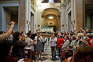 Roma 13 Ottobre 2013.<br /> Festa della Nossa Senhora da Conceição Aparecida (Nostra Signora della Concezione di Aparecida), la patrona del Brasile, che si festeggia il 12 ottobre e la comunita' brasiliana di Roma festeggia con una processione per le vie del centro storico. La processione entra nella chiesa di Santa Maria della Luce della comunità latino americana di Roma<br /> Rome 13 October 2013<br /> Feast of Nossa Senhora da Conceição Aparecida (Our Lady of Conception Aparecida), the patron saint of Brazil, which is celebrated on October 12 and the community Brazilian Roma celebrated with a procession through the streets of Old Town. The procession enters the church of Santa Maria della Luce of the Latin American in Rome