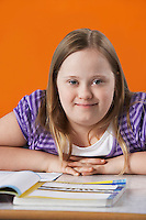 Portrait of girl (10-12) with Down syndrome in classroom