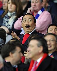 Cardiff City owner, Vincent Tan yawns - Photo mandatory by-line: Joe Meredith/JMP - Tel: Mobile: 07966 386802 03/11/2013 - SPORT - FOOTBALL - The Cardiff City Stadium - Cardiff - Cardiff City v Swansea City - Barclays Premier League
