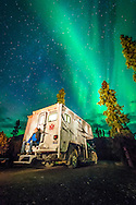 Yukon Territory, Canada, September 2014. The Aurora Borealis Northern lights over Tombstone Campground.  The Dempster Highway is Canada's only 4 season road to cross the Arctic Circle. This scenic dirt road, that passes through spectacular mountain wilderness of Tombstone Territorial Park with lots of wildlife,  connects Inuvik to the outside world. With scenic drives in abundance, the Yukon Territory is a driver's dream. The territory boasts a network of well-maintained highways leading through an exhilarating combination of postcard scenery, historic communities, cultural attractions and adventure outings.The Yukon Territory received world fame during the Klondike Gold Rush in 1898.  Photo by Frits Meyst / MeystPhoto.com