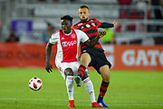 Ajax midfielder Bertrand Traore (23) and Flamengo midfielder Leo Duarte (43) go for a ball during a Florida Cup match at Orlando City Stadium on Jan. 10, 2019 in Orlando, Florida. <br /> Flamengo won in penalties 4-3.<br /> <br /> ©2019 Scott A. Miller