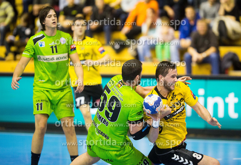 Angel Romero Rodriguez of Naturhouse La Rioja vs Senjamin Buric of Gorenje during handball match between RK Gorenje Velenje and Naturhouse La Rioja in Round 6 of Group D of EHF Men's Champions League 2013/14, on November 23, 2013 in Rdeca dvorana, Velenje, Slovenia. Photo by Vid Ponikvar / Sportida