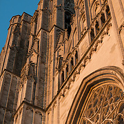 The distinctive twin towers of the Cathedral of St. Michael and St. Gudula capture the golden light of the last rays of sunshine for the day. Standing prominently on a hill in central Brussels, the current cathedral dates back to the 13th century, although a church has been on this site at least since the 11th century. It is the national cathedral of Belgium and site of royal coronations and weddings.