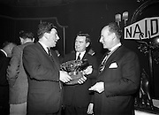 05/04/1966<br /> 04/05/1966<br /> 05 April 1966<br /> Presentation Awards for entries in the N.A.I.D.A. Parade at the Shelbourne Hotel, Dublin. Photo shows  Mr. W.J. O'Toole, Sales Promotion, W. & R. Jacob and Co. Ltd. (Left) receiving the 2nd prize Arklow Pottery Perpetual Award from  Mr. L.V. Nolan, President of the N.A.I.D.A., centre is Mr. Diarmuid O'Broin, Secretary N.A.I.D.A..