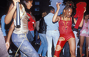 Girls dancing, one in a skimpy red outfit, Notting Hill Carnival, 2002