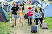 Arrivals, mostly with overloaded bags but one group with a ready assembled tent. The 2014 Glastonbury Festival, Worthy Farm, Glastonbury. 26 June 2013.  Guy Bell, 07771 786236, guy@gbphotos.com