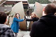 Dorosan/South Korea, Republic Korea, KOR, 28.11.2009: Tourists at the Dorasan Observatory getting photographed infront of a sculpture.