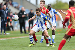 Sam Saunders of Colchester United holds off a chanlenge from David Wheeler of Milton Keynes Dons - Mandatory by-line: Arron Gent/JMP - 27/04/2019 - FOOTBALL - JobServe Community Stadium - Colchester, England - Colchester United v Milton Keynes Dons - Sky Bet League Two