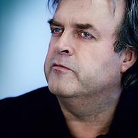 Nederland, Amsterdam , 2 november 2012.<br /> Rondetafelgesprek mediajournalisten in Lloyd Hotel.<br /> v.l.n.r. Jean Pierre Geelen (48)3,5 jaar recensent Volkskrant<br /> Hans Beerekamp (60) sinds 2003 NRC<br /> Mark Moorman (52) Al twintig jaar in Lips-carousel<br /> Willem Pekelder (53) Bijna 3 jaar Trouw<br /> Op de foto journalist Mark Moorman.<br /> <br /> Foto:Jean-Pierre Jans