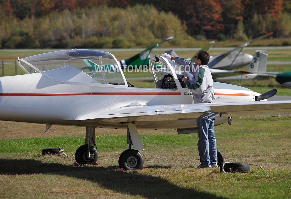 Wurtsboro, New York - A pilot cleans the windshield his Valentin 17E Taifun motorglider at Wurtsboro Airport on Oct. 9, 2010.