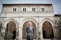 CASTIGLONE A CASAURIA, ITALY - APRIL 8: Bertrand du Vignaud, President of the World Monuments Fund, poses at the inauguration ceremony of the Historic Abbey of San Clemente was returned to its community fully restored two yers after it was damaged by the devastating 2009 Abruzzo earthquake in Italy, on April 8, 2011 in Castiglione a Casauria, Italy. Following the earthquake, Bertrand du Vignaud, President of World Monuments Fund Europe, in coordination with the Italian Ministry of Culture, identified the twelfth-century Abbey of San Clemente a Casauria as a priority project. World Monuments Fund (WMF), the foremost independent, nonprofit historic preservation organization, and the Fondazione Pescarabruzzo, the most important local benefactor, agreed to cover the total cost of the conservation program.<br /> <br /> Gianni Cipriano for The New York Times