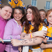 Hannah Lyons showing off her arms full of clare hurlers signatures