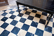 checkered floor and black wooden table in a church