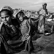 A Rohingya refugee with her child suffering from severe malnutrition in Balukhali refugee camp. Since the end of august 2017, the beginning of the crisis, more than 600,000 Rohingyas have fled Myanmar to  seek refuge in Bangladesh. Cox's Bazar -october 28th 2017.<br /> Une femme Rohingya avec son enfant souffrant de malnutrition s&eacute;v&egrave;reDepuis le d&eacute;but de la crise, fin ao&ucirc;t 2017, plus de 600000 Rohingyas ont fuit la Birmanie pour trouver refuge au Bangladesh. Cox's Bazar le 28 octobre 2017.