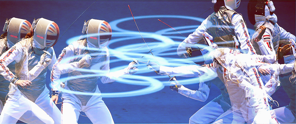 Great Britain's Sophie Troiano and Egypet's El Hussein  in action pictured using multiple exposure function on the camera ,with the Olympic rings in the centre during the  Women's Foil Team Fencing last 16 against Egypt at the Excel Arena,London  PRESS ASSOCIATION Photo. Picture date: Thursday August 2, 2012. See PA story OLYMPICS . Photo credit should read: Julien Behal/PA Wire. EDITORIAL USE ONLY