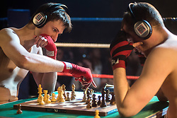 © Licensed to London News Pictures. 23/03/2013. London, UK. Chris Levy (R) and Matt Read compete in a bout of Chessboxing Grand Prix in Scala, London, Saturday evening 23 March 2013. The hybrid sport combines chess with boxing in alternating rounds. The winner is decided by a knock out or checkmate, whichever comes first. A full match consists of eleven rounds: six rounds of chess, each four minutes long, and five rounds of boxing, each three minutes long (four minutes under amateur rules).[4] The match begins with a chess round which is followed by a boxing round. Rounds of chess and boxing alternate until the end of the match.[1][5] There is a one-minute break between each round, during which competitors cool out and change gear.. Photo credit : Peter Kollanyi/LNP