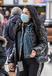 © Licensed to London News Pictures. 03/03/2020. London, UK. A young women heads to work wearing a mask in Westminster as Boris Johnson announces his battle plan in Downing Street for combating the coronavirus crisis. Photo credit: Alex Lentati/LNP