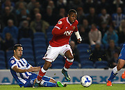 Bristol City striker Jonathan Kodjia evades the challenge from Brighton central midfielder Beram Kayal during the Sky Bet Championship match between Brighton and Hove Albion and Bristol City at the American Express Community Stadium, Brighton and Hove, England on 20 October 2015. Photo by Bennett Dean.