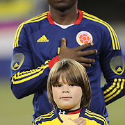 A young boy with the Colombian team during the Colombian National Anthem before the Brazil V Colombia International friendly football match at MetLife Stadium, New Jersey. USA. 14th November 2012. Photo Tim Clayton