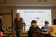 November 11, 2013 - New York, NY. Joe Delfausse walks through people preparing for a class on the solar system organized by the Amateur Astronomers Association of New York. 11/11/2013 Photograph by Kathleen Caulderwood/NYCity Photo Wire.