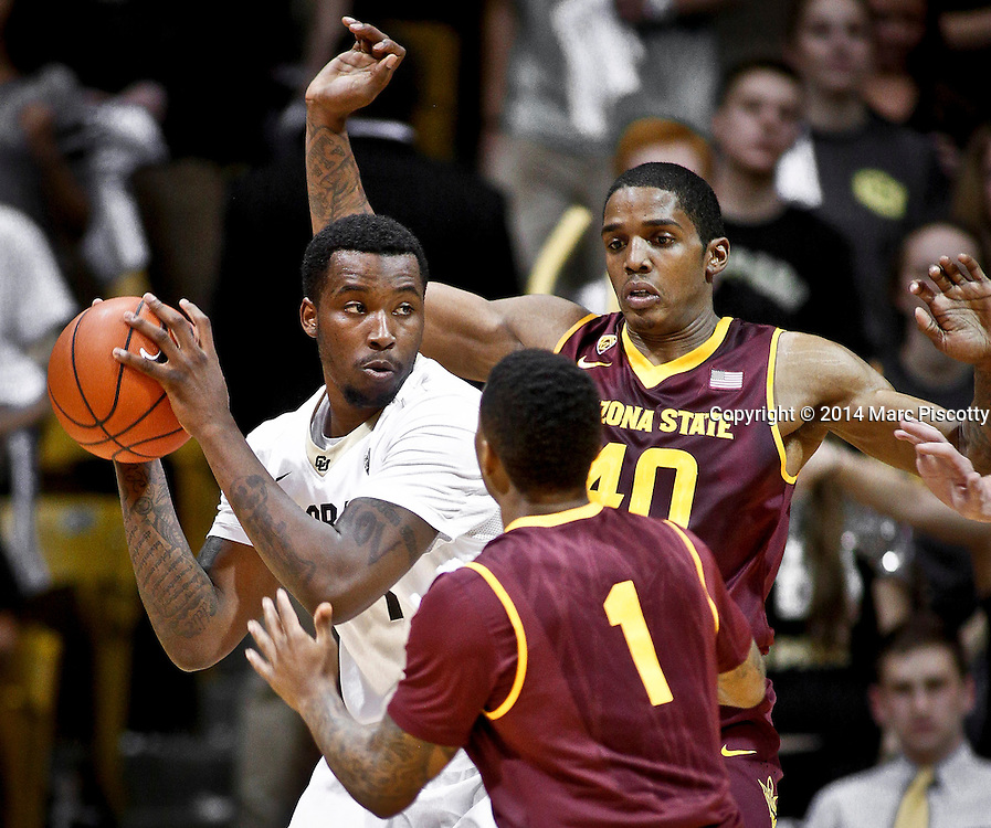 SHOT 2/19/14 10:50:42 PM - Colorado's Wesley Gordon #1 looks to pass while being double teamed by Arizona State's Shaquielle McKissic #40 and Jahii Carson #1 during their regular season Pac-12 basketball game at the Coors Events Center in Boulder, Co. Colorado won the game 61-52.<br /> (Photo by Marc Piscotty / &copy; 2014)