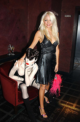 MISS HANNAH SANDLING at a party to celebrate a new collection of sexy underware by Janet Reger called 'Naughty Janet' held at 5 Cavendish Square, London on 19th October 2004.<br />