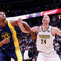 03 April 2018: Indiana Pacers center Myles Turner (33) vies for the rebound with Denver Nuggets center Mason Plumlee (24) during the Denver Nuggets 107-104 victory over the Indiana Pacers, at the Pepsi Center, Denver, Colorado, USA.