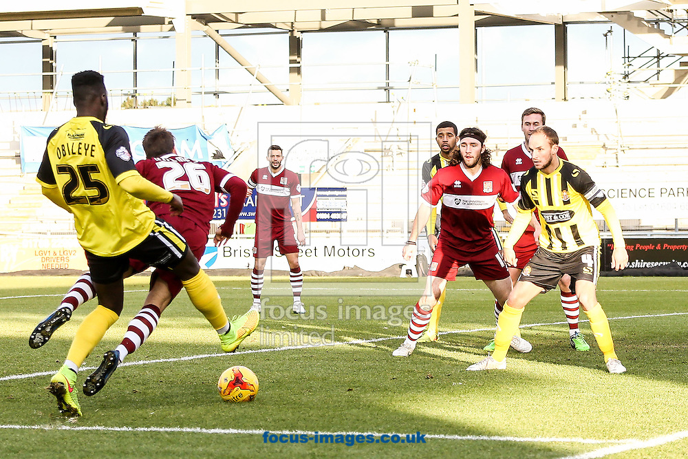 Ricky Holmes of Northampton Town (2nd left) goes down in the penalty box during the Sky Bet League 2 match at Sixfields Stadium, Northampton<br /> Picture by Andy Kearns/Focus Images Ltd 0781 864 4264<br /> 17/01/2015