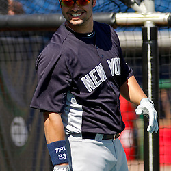 February 27, 2011; Clearwater, FL, USA; New York Yankees right fielder Nick Swisher (33) during batting practice before a spring training exhibition game against the Philadelphia Phillies at  Bright House Networks Field. Mandatory Credit: Derick E. Hingle