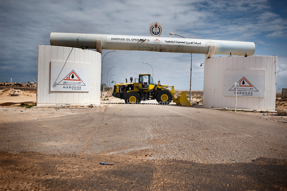 LIBYA, BIN JAWAD:  A bulldozer close the acces to a refinery near to  Bin Jawad on March 11, 2011. ALESSIO ROMENZI