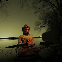 A Buddha by a lakeside