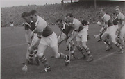 The throw in at the 1954 All-Ireland Final. Cork players are Willie John Daly, Johnnie Clifford, Christy Ring, J Hartnett and P Barry. The Wexford players are P Kehoe, B Donovan, N Rackard and S Hearne.